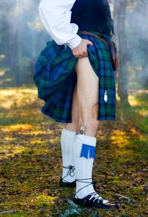 Hot Scotsman lifting his kilt