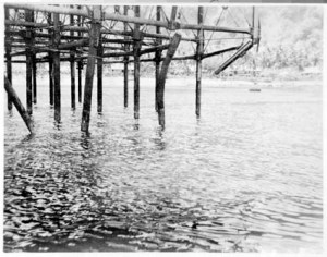 Damaged Pier in Flying Fish Cove, 1945