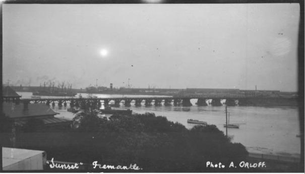 Double rail bridge in 1923 at sunset