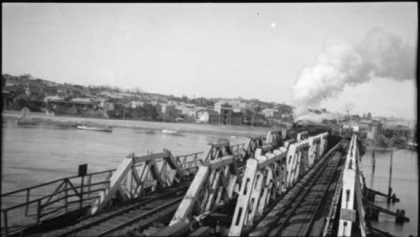 1924 Rail bridge pre flood looking south with freight train on it low res