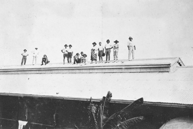 Cable station staff and Emden raiding party watching Battle of Cocos from the Direction Island cable station roof