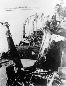 Damage on the Emden, with the Sydney in the background