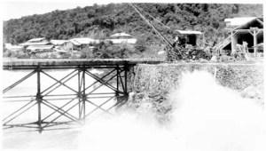 Rough seas breaking over new pier, Jan 1932