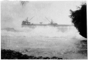 Sea breaking through No 3 pier on 2 Jan 1932