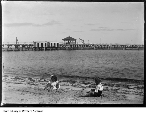 Children playing on shore beside the Busselton Jetty, circa 1910